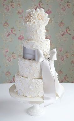 Lace & Blossom wedding cake by Cotton and Crumbs. Lovely and romantic with a vintage touch in soft peach and grey.