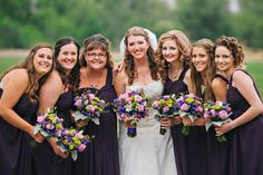Purple and green bridal party bouquets.