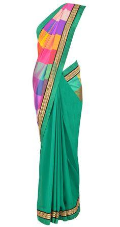 Dark green chiffon saree with multicolored silk pallu by TISHA SAKSENA. Shop at https://www.perniaspopupshop.com/whats-new/tisha-saksena-1