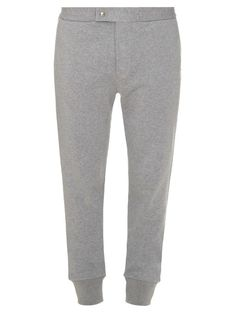 Moncler Gamme Bleu's light-grey melange track pants are the perfect choice for off-duty days. They have a relaxed leg that's enlivened with white striped pockets, and the label's signature details – an embroidered logo and navy, white, and red pull tab. They fit large to size, so we suggest taking a size smaller. | Available at MATCHESFASHION.COM
