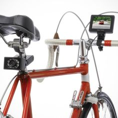 "The OWL 360 Bicycle Rearview Camera mounts to a bicycle for providing a clear view of the road behind. The 2 1/4"" W x 1 1/2"" H camera mounts to a bicycle's seat post, providing a rear-facing 75º field of view ideal for seeing approaching vehicles or other cyclists. A 78 3/4"" zip-tied cable that accommodates any frame geometry connects the camera to the handlebar-mounted 3 1/2"" TFT color monitor (fits bars up to 1 1/4"" diameter); quick-release mechanism removes the monitor easily from ..."