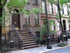 """Carrie Bradshaw's NYC brownstone was fictionally located at 245 E. 73rd Street, between Park and Madison. However, the actual location is 66 Perry Street, between Bleeker and 4th. A rope has been added to the front of the building to avoid """"SATC"""" fans from using the stoop for personal photos, since residents live in the building."""