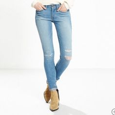 """Levi 711 Skinny Jean """"Lasting damage"""" color. Mid-Rise. Slim through hip and thigh. Skinny leg; 10.5"""" leg opening. Soft stretch fabric. Intended ripping at knee and some small detailed rips on front right hand side of Jean pocket. Slightly worn - very comfortable! Levi's Jeans Skinny"""