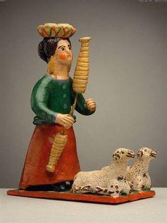 Mulher fiando com duas ovelhas. Estremoz. MNE. Matriznet.