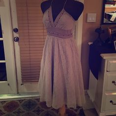 Heading to the Beach dress Colcci is a Brazilian clothing company that manufactures high-end clothing. Cotton, lace and delicate beading. Dress is a taupe/lavender tone and has never been worn. Tags fell off during staging but are shown in last pic. Colcci Dresses
