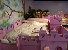 Top view of Girl's Princess castle Bed. They leave no details unturned with natural forrest mural painting on the wall.