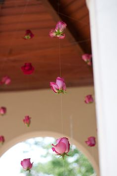 love this idea of stringing flowers to hang from a gazebo... perfect for a wedding ceremony