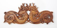 Stags of the Ancient Woods: Celtic lore regards the stag as one of the oldest animals of creation; within this majestic animal lies the deep wisdom of the ancient woods. Two stags intertwine in zoomorphic knotwork on this remarkable hand-carved wooden plaque. Made of a single piece of mahogany, individually hand-carved and buffed with a paste-wax finish to bring out the essence of the wood. Each is an individual work of art and craft; expect variation.