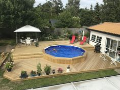 wood deck round above ground pool Above Ground Pool Landscaping, Backyard Pool Landscaping, Backyard Pool Designs, Small Backyard Pools, Round Above Ground Pool, Pool Deck Plans, Pool Spa, Swimming Pools Backyard, In Ground Pools