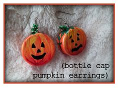 Cute bottle cap earrings.  I think I would use bottle caps off of glass bottles in place of the plastic screw tops though.