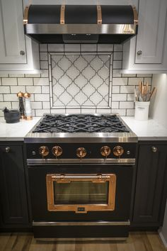 This stove is everything we've ever dreamed of. See the rest of this amazing kitchen! #kitchendesign #modern