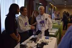 NYPMA's Harriet and Len sharing a laugh with HIBU's Nikelle and Scott — at DoubleTree by Hilton Fort Lee.