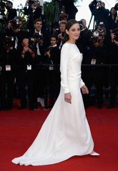 French actress Marion Cotillard at the premiere of her new film, The Immigrant, wearing a Dior gown