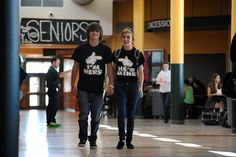 Eleventh grader Anthony Hansen, 16, and 10th grader Siera Chavez, 15, exit a cafeteria wearing matching outfits during Spirit Week activities Sept. 19 at Falcon High School in Falcon School District 49. Throughout the week leading to homecoming, students are supporting clothing theme days, including neon, class color, superhero, twin and whiteout. During tomorrow's homecoming game, the Falcons will take on the Rams from Rampart High School Football in Academy School District 20.