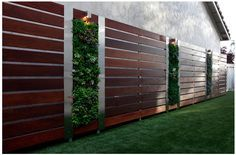 Vertical gardens and wooden privacy screens instantly make any garden look sleek and modern.  Ref: http://www.houzz.com