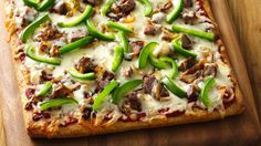 Philly Cheese Steak Pizza - A delicious twist on the traditional roast beef sandwich, with tasty toppings served hot on pizza crust.
