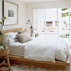 Organic Vibe - This simple platform bed feels welcoming covered with cozy organic linens. The natural feel is enhanced by a tree trunk bedside table, lots of natural light streaming through large windows, and a door that leads to the back patio.
