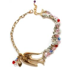 """This gorgeous necklace bringsa vintage gold tone swallow, a red, clear and a gold tone heart pendants hanging from the itsbeak, silver and gold tone chains, clear paste necklace and antique pink, red and blue glass beads.Stylish, delicate and yet powerful, this delightful piece is just the right touch to a perfect outfitHand made in London in the spirit of Maria Zureta  """"…I LOOK UP TO THE LITTLE BIRDTHAT GLIDES ACROSS THE SKYHE SINGS THE CLEAREST MELODYIT MAKES ME WANT TO CRY…""""…"""
