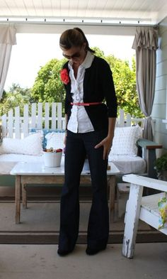 black cardigan, white ruffled oxford shirt, denim trousers, black suede wedges, coral skinny belt and flower pin - the pleated poppy
