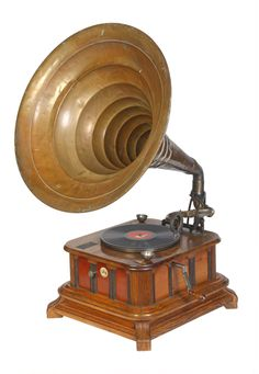 Mammut automatic gramophone | German | 1904 - 1911 |   | coin-operated playback and recording  | user  winds up the motor and puts a disc on the turntable, but the motor won't start until a coin's inserted. this is a rare survivor of the many automatic phonographs and gramophones that preceded the jukebox.