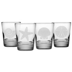 Bring the beach to your home barware collection with this set of four Seashore Double Old Fashioned Glasses. Each heavy-based 13.25-ounce tumbler features a different sand etched emblem of the sea, in