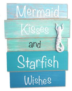 "This Caifornia Seashell Company exclusive wood plank sign with gorgeous coastal blue and green tones says 'Mermaid Kisses and Starfish Wishes"" and is adorned with a white resin mermaid with rhinestone accents"