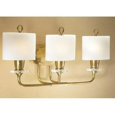 StylIcon Meridian Brass Three-Light Bath Fixture by Stylicon. $320.00. Purity of line, integrity in solid brass construction, and a thoroughly modern appeal are the hallmarks of this sconce. Finished in acquisition brass with frost white cased glass and 24% lead crystal bobeches, this piece is a must for your upscale décor.