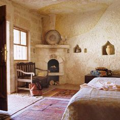 LOVE the corner wood stove Guest Cottage Plans, Corner Wood Stove, Home Bedroom Design, Bedroom Ideas, Stone Cottages, Adobe House, Bohemian House, Sustainable Living, My Dream Home