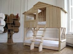 wooden bunk bed designed like a house