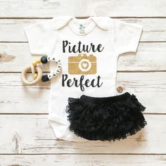 - Made of 65% cotton and 35% Polyester for an incredibly soft feel. - 1x1 rib for extra give in the belly area - Lap-shoulder neckline for easy dressing - Snap closure for ease of changing baby's diap