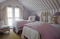Double beds in a room with a slanted ceiling