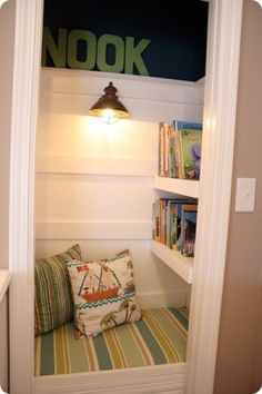 I'm in love with this idea - what a great way to use an awkward closet space... A book nook !