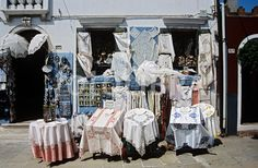 Lace gifts and souvenirs for sale outside a shop on the island of Burano, Venice, Italy