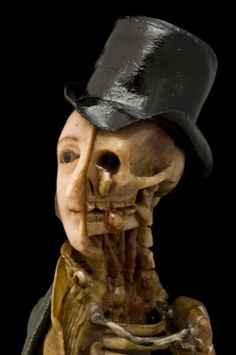 Coloured wax model of a male, half skeletal, half living and dressed in regency clothing, England, 1810-1850