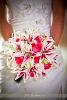 Roses  Stargazer Lillies. This is really pretty and a great way to incorporate other colors besides pink too like yellow or something.