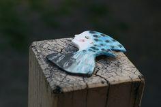 Blue hooded girl porcelain brooch