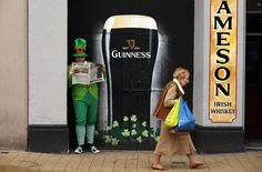 A man dressed as a Leprechaun reads a newspaper during St Patrick's Day festivities in the city of Londonderry March 17, 2015. REUTERS/Cathal McNaughton