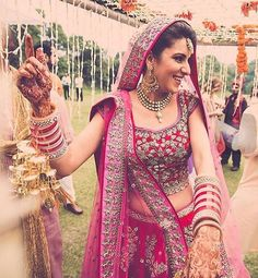 Just how lovely does Jade look in a deep red and pink lehenga on her big day!  #TheARBride ✨