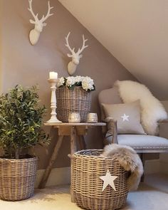 White stags head...toasted beige wall...wicker baskets..sheepskins...#hygge #scandistyle