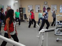 Instructor Karen Lee leading attendees of the GOLDY LUCK AND THE THREE PANDAS book reading in Tai Chi exercises.