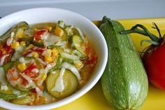 Calabacitas- A Mexican-Style Zucchini Side Dish~ I add in a deveined and seeded jalapeno and a bit of mexican tomato sauce(el pato). Also, i use fresh garlic instead of powder.