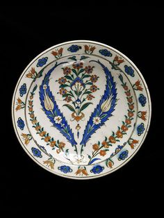 |Dish Place of origin: Iznik, Turkey (made)  Turkey  Date: ca. 1565-75 (made) Artist/Maker: Unknown (production) Materials and Techniques: Fritware, polychrome underglaze painted, glazed.  V&A Search the Collections