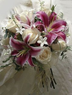 and Stargazer Bouquet Stephanotis Rose and Stargazer Lily bouquet this is gorgeous! After roses.Stargazers are my fav!Stephanotis Rose and Stargazer Lily bouquet this is gorgeous! After roses.Stargazers are my fav! Stargazer Lily Bouquet, Stargazer Lily Wedding, Lily Bouquet Wedding, Bride Bouquets, Rose Bouquet, Floral Wedding, Tiger Lily Bouquet, Boquette Wedding, Wedding Ideas