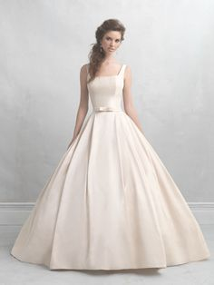 Madison James MJ05   If ever there was a gown that embodied sweetness, it's this creamy taffeta ballgown. Its only ornamentation is a small bow at the waist, while the square neckline leads to a scooped back.