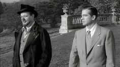 Karswell discusses the supernatural with Holden as they stroll through the grounds of his house - Night of the Demon (1957)