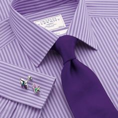 Lilac two colour bengal classic fit dress shirt from Charles Tyrwhitt. Wear it with a dark blue suit, brown belt and brown oxfords. Don't forget the matching pocket square.