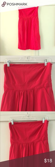 J.CREW STRAPLESS SUNDRESS Reddish blue tube top style dress from J. Crew. Material is pique cotton, like a polo shirt. Empire waist with side pockets. Hits above knee. Side zipper and rubber on the inside at the top to keep the dress in place. 100% cotton. 30 inch bust. Length of dress is 30 inches. J. Crew Dresses Strapless