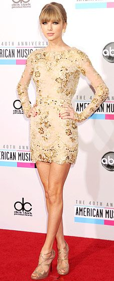 Taylor Swift shimmered in a Zuhair Murad frock at the AMAs Nov. 18.