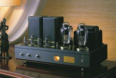 The famous Air Tight ATM-300 Stereo Amplifier. 300B Triode vacuum tubes deliver 8 watts per channel into 2 channels. USD about 10,000, depending on tube choice.