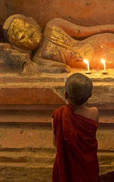 Young devotion . Bagan Myanmar